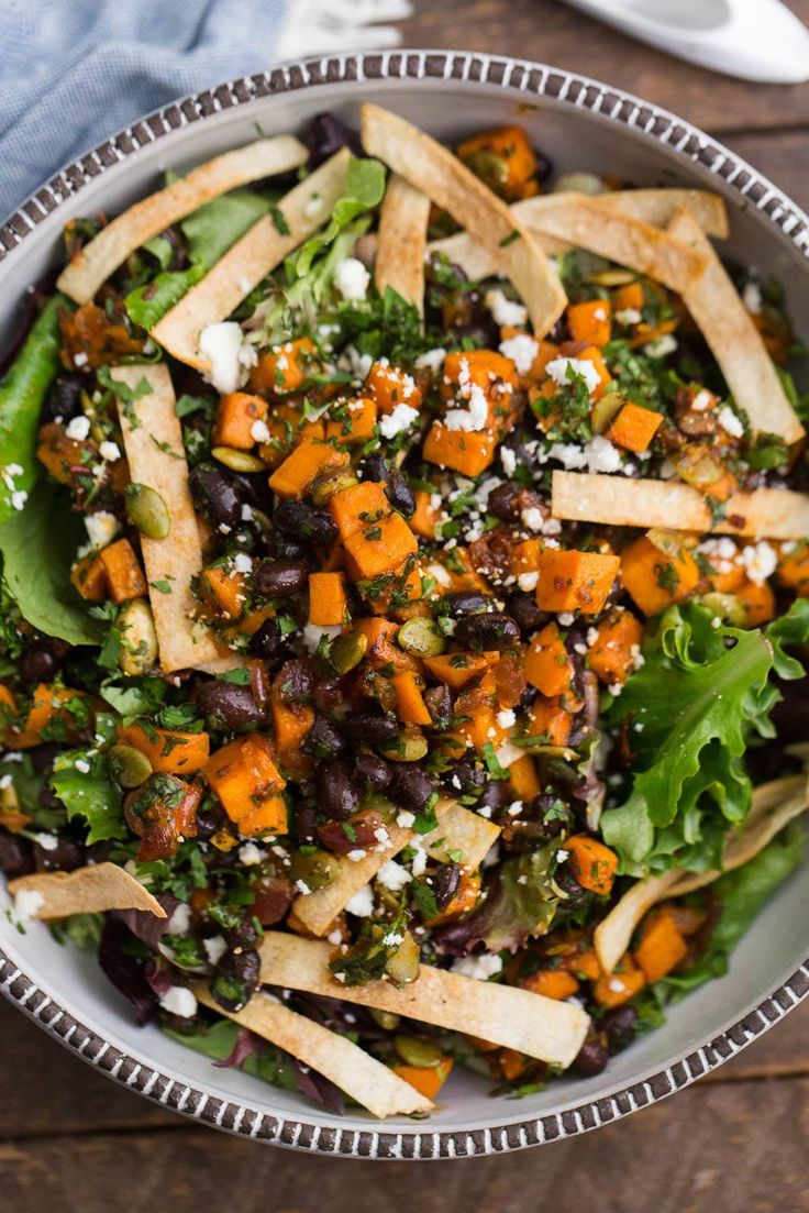 A vegetarian, easily vegan, taco salad that features chipotle sweet potatoes, black beans, and homemade crisp tortilla strips.