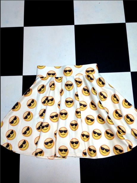 CRAZY SEXY COOL! Tailored skater skirt ft. #OMIGHTY OG sunglass emoji print Fit & Flare Slight stretch Zipper closure