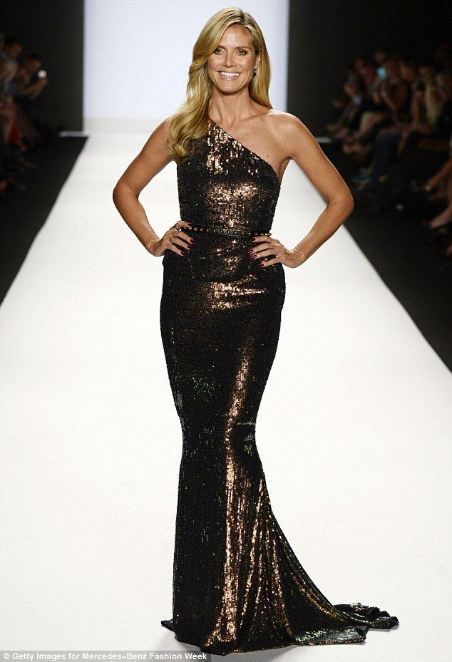 Show stopper: Heidi Klum stole the show at Project Runway's Spring 2014 catwalk show held at the Lincoln Centre during Mercedes-Benz Fashion Week on Friday in this bronze gown