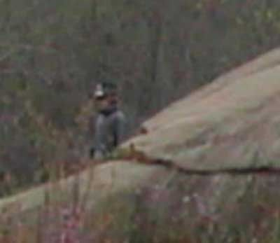 "This picture was taken at the Devil's Den in Gettysburg... On 4-3-05. ""There were not any reenactors there at that time. I made for certain that during my trip, I did not take any pictures of anyone dressed in Civil War era clothing because I was there on a ghost hunting trip. The first photo is the full size picture, the second is a close-up of the soldier."""