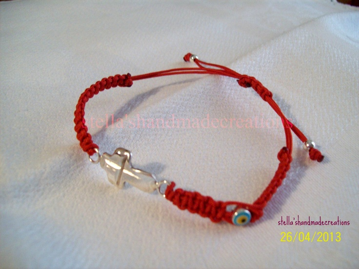 macrame bracelet with handmade 925 silver cross with ivory eye and silver elements