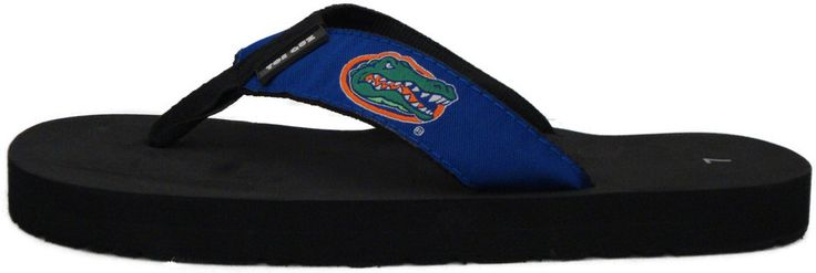 University of Florida Flip Flops for Men and Women by ToeGoz $18.99. The University of Florida (Gator chomp) flip flops for Men and Women by ToeGoz have a solid blue strap with the signature Florida Gator head. Women should order their regular size, with a half size order UP to the nearest whole size. Men should order one size larger than their normal size, with a half size order up one and half sizes.  High EVA for Durability, Low EVA for Comfort, Fabric Straps, Unisex, Great for…