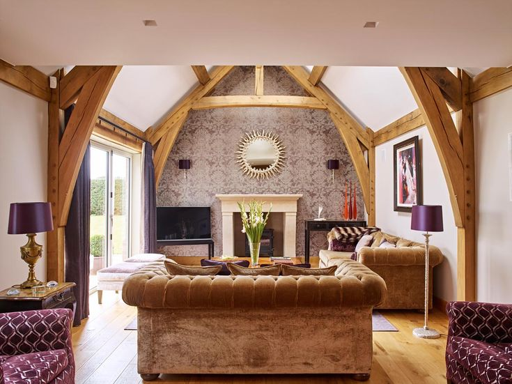 The oak frame adds wow factor to this lounge area and the vaulted ceilings create a more spacious look and feel.