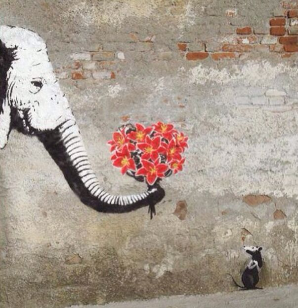 From the rat, I guessing this is another piece from the symbolic genius - Banksy.
