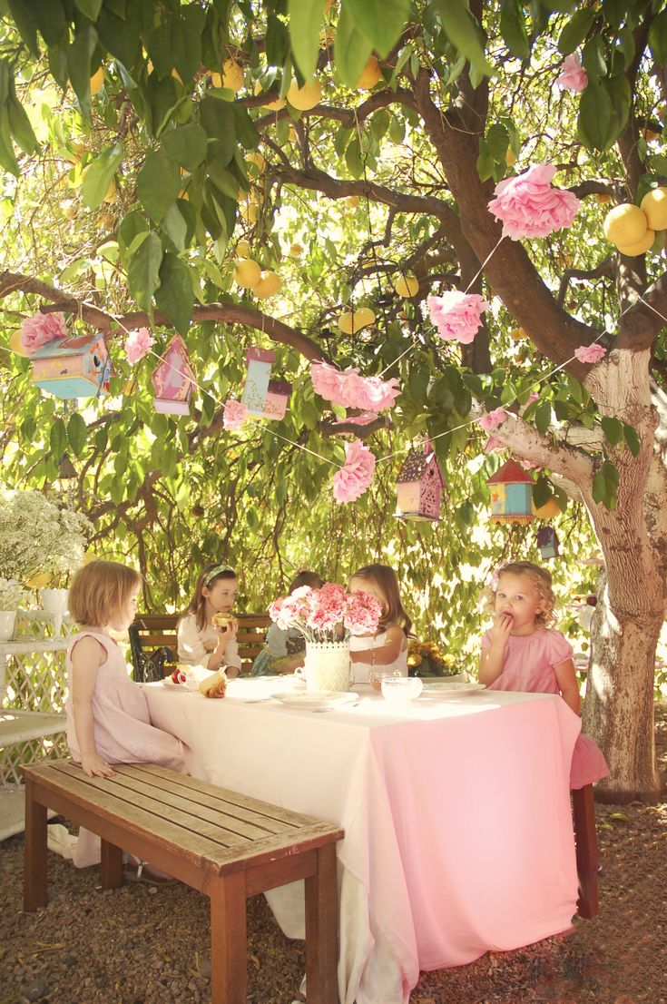 Pink Tea Party...love the paper flowers hanging from the grapefruit tree