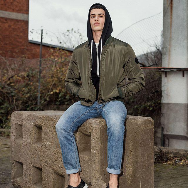 Keep it casual: black hoodie, white tee, military green bomber jacket, blue denim jeans and black sneaks   JACK & JONES #menswear #men #style #look #easy #urban #street