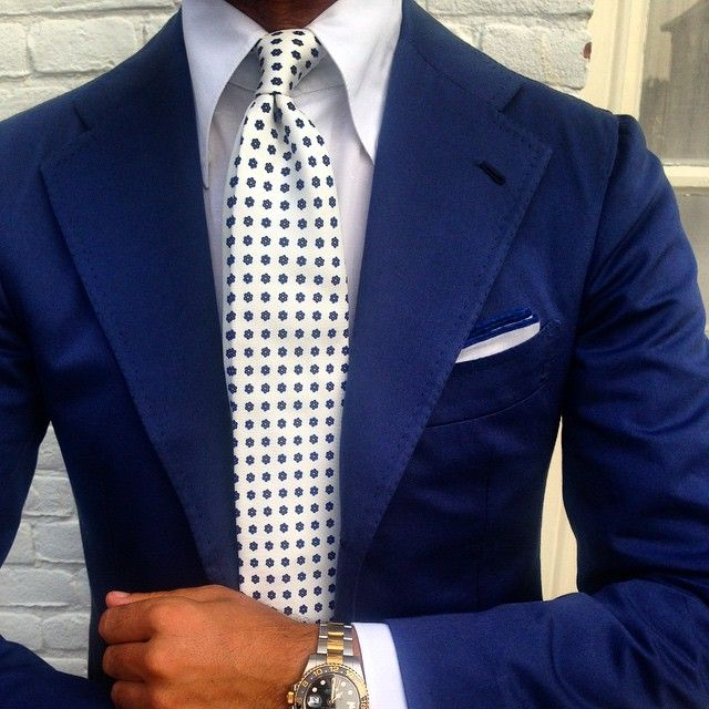 Blue suit, ivory tie from Viola Milano