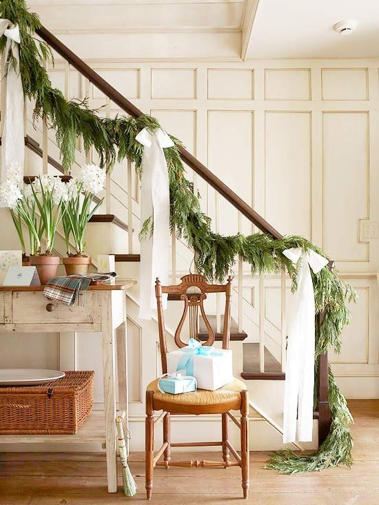 Stairs with greenery  21 of 30  Go for Drama        Graceful bows with long tails dramatically enhance a simple evergreen garland. Cut extra-long strips of material, tie into bows, and attach to the stair railing about 3 feet apart.