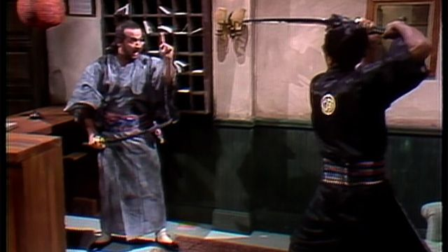 In the first appearance of Samurai Futaba (John Belushi), a customer (Chevy Chase) checks into a hotel where the desk clerk (Belushi) and bellboy (Richard Pryor) are sword-wielding samurai who fight over who will carry his bags. [Season 1, 1975]