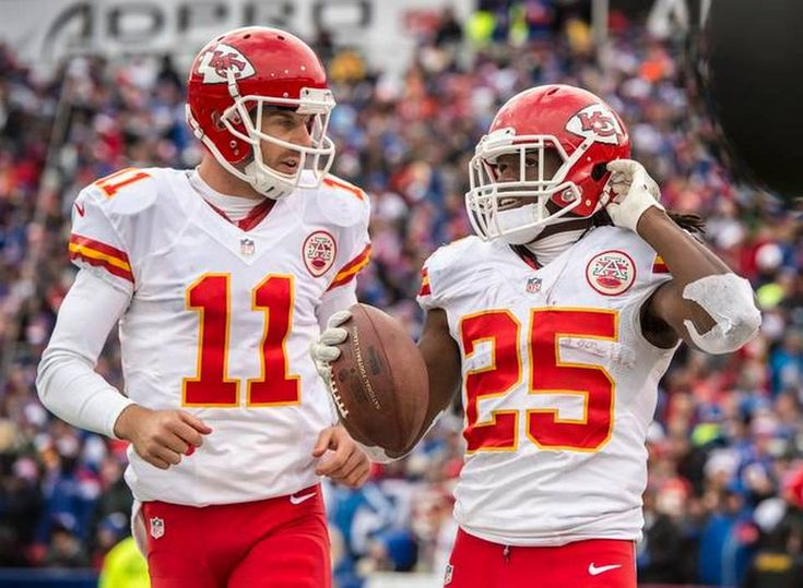 Kansas City Chiefs quarterback Alex Smith (11) congratulated Kansas City Chiefs running back Jamaal Charles (25) after his 39-yard touchdown run in the fourth quarter on a 4th down-and-1 yard run during NFL action on November 9, 2014 at Ralph Wilson Stadium in Orchard Park, NY. The Chiefs won 17-13.