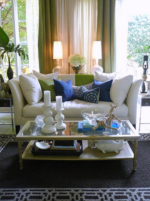 Loving the bright colors with crisp white furniture
