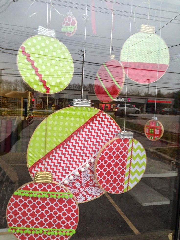 TabboDesign: Banasch's Fabrics // Festive holiday store window display using embroidery hoops - featuring Riley Blake Dot, Chevron, Quatrefoil, and Damask fabrics. #iloverileyblake #holidaydecor