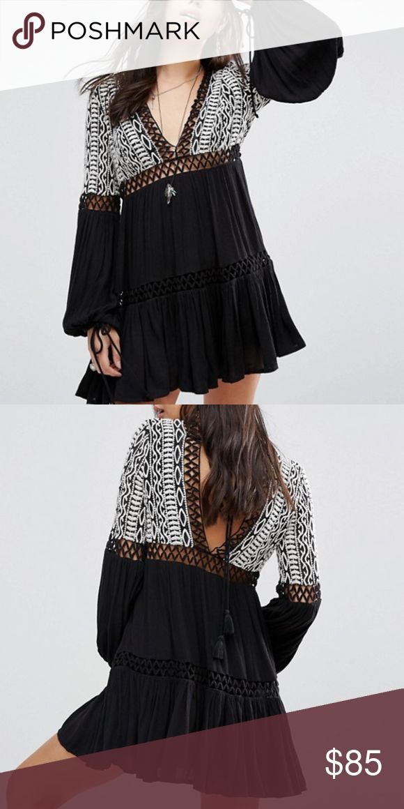 FREE PEOPLE DUSK TIL DAWN Long sleeve mini dress featuring a gauzy fabrication and pretty tribal-inspired embroidery on the bodice. Deep V-neckline with adjustable tasseled tie closure at the back. Peek-a-boo crochet panels throughout. Drawstring ties on the sleeve cuffs. Lined. Care/Import Machine Wash Cold Import Measurements for size 6 Waist: 31.5 in Length: 33.5 in Sleeve Length: 26 in Free People Dresses Mini