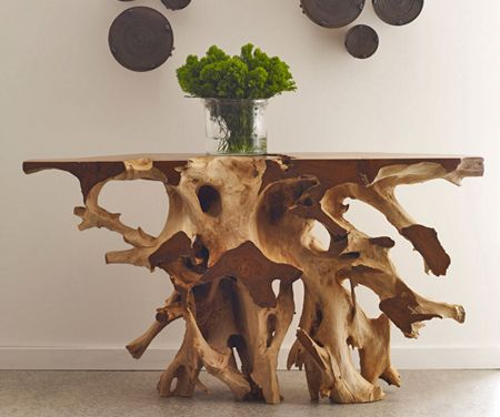 One of the signature pieces in our Contemporary Rustic Collection, this root console table is truly a work of art. Handpicked for its natural beauty, this solid wood design is painstakingly coaxed into a finished product from a rough-hewn root ball of a hardwood species. The spectacular contrast between the polished and natural finish sections