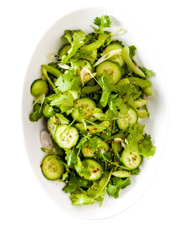 "spicy ""tiger"" salad with cucumbers, celery, cilantro, sesame seeds, and red pepper"