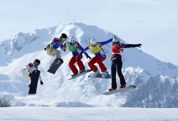 Athletes compete in the women's snowboard cross semi-finals.