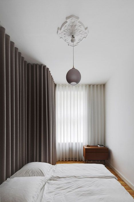 Berlin apartment interior by Atheorem, luxury ripple fold drapery