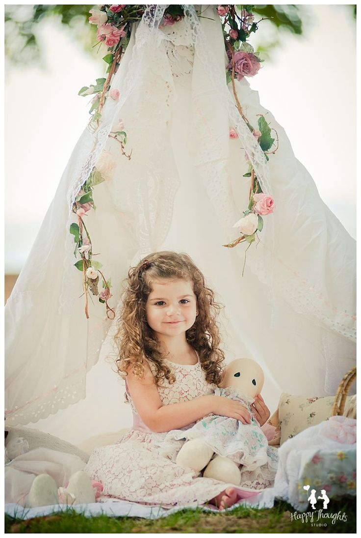 Cute vintage Girl playing with dolls in outdoors tent Children Photography