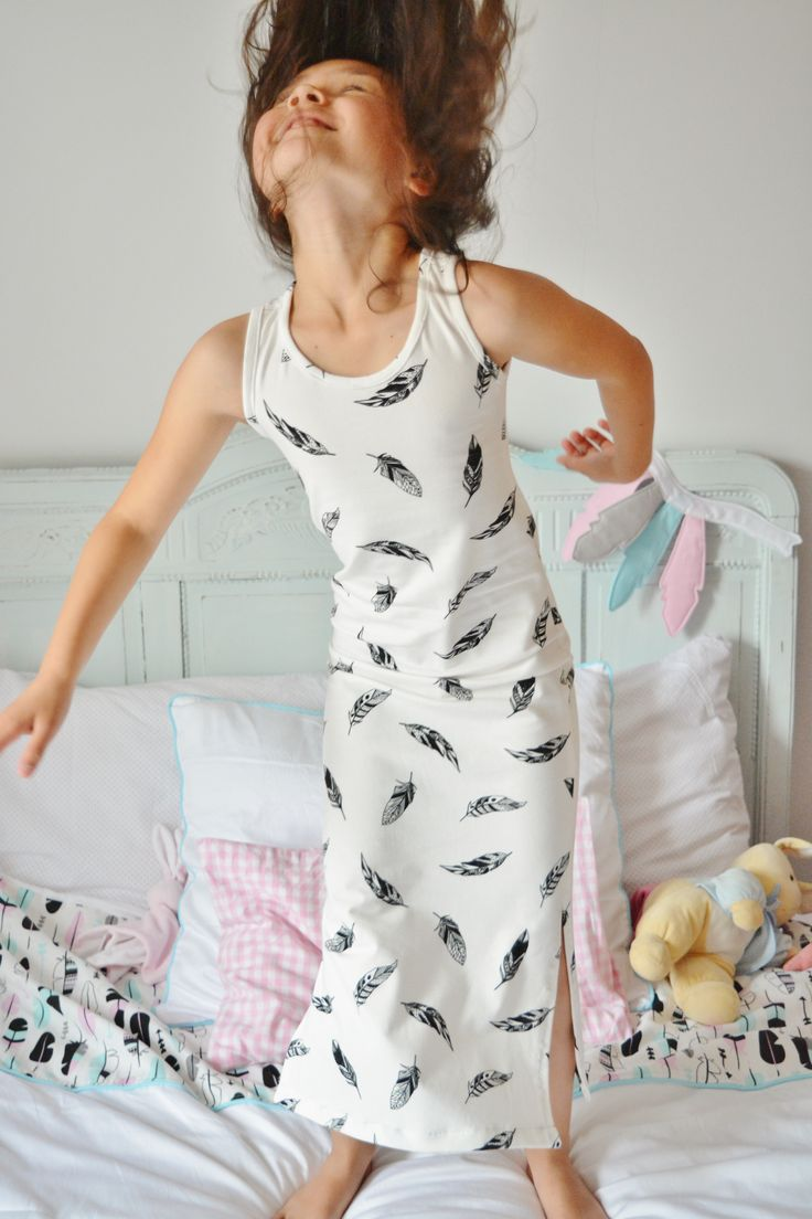 Having fun in her Maxi Feather Dress by Wazzhappening