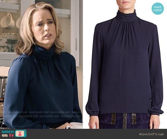Elizabeth's navy blue turtleneck blouse on Madam Secretary.  Outfit Details: https://wornontv.net/53482/ #MadamSecretary