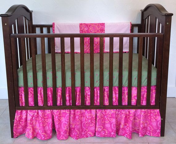My Rainforest Pink Baby Crib Bedding by Dance With Joy® includes a fitted baby crib sheet, a full flowing bed skirt, and a blanket. Rainforest Pink Baby Crib Bedding takes you and your child to a tropical paradise with opulent fabrics! My Dance With Joy® adjustable bed skirt is