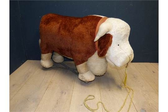 Large 1960's 'Merrythought' model of Hereford bull on rolling wheels 60Hx103W PLEASE always check