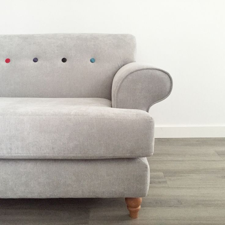 Grey sofa with coloured buttons.