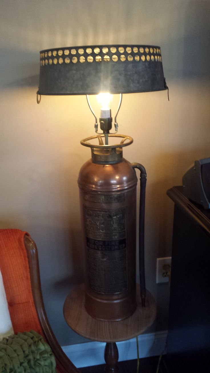 Fire extinguisher lamp with coal shaker as