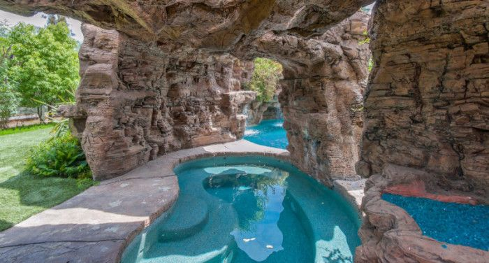 Pool grotto - Pool with waterfalls, beach entry, & grotto is a showstopper. Denise Richards merged two pools to create her lagoon-style pool at her Hidden Hills, LA home. There is also a custom-built 800-square-foot cabana, outdoor kitchen, & lush manicured lawns.