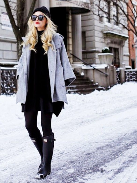grey cape + black turtleneck sweater + black skirt + black tights + black Hunter wellies + black beanie