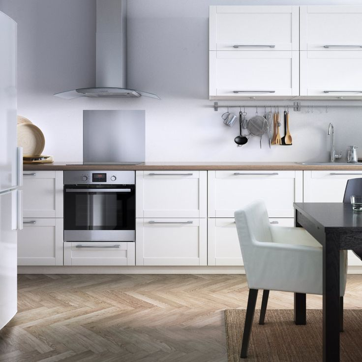 14 Modern Affordable Ikea Kitchen Makeovers: Modern White Eat-in IKEA Kitchen With Stainless Steel