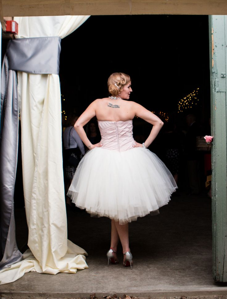 A custom white wedding suit and tutu-inspired reception dress at this glam meets rustic wedding