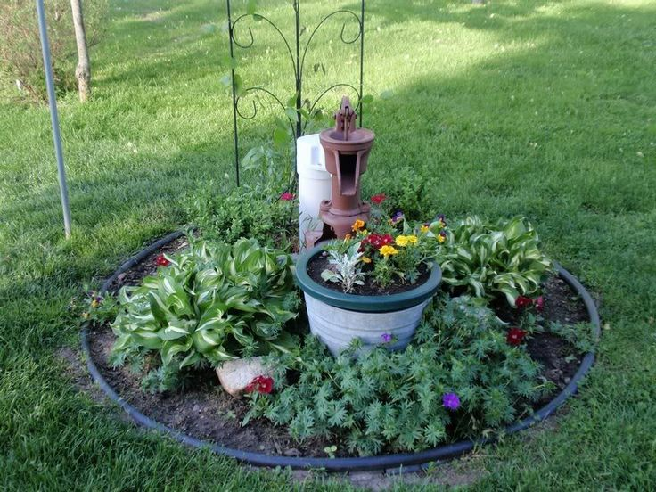 Best Ways To Hide Well Covers Images On Pinterest Landscaping