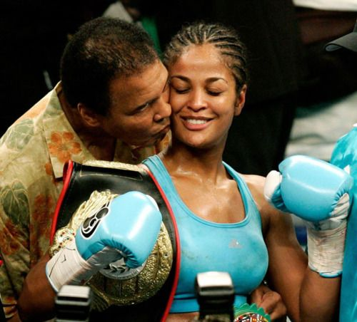 Muhammad Ali and his daughter, Boxer Laila Ali, after she won a fight in 2005