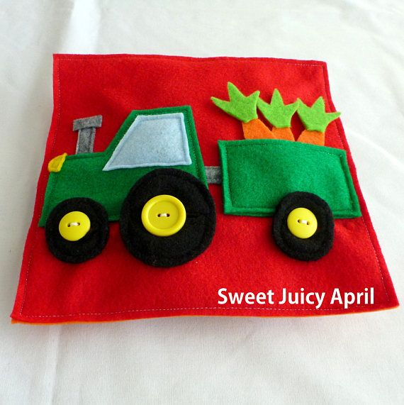 Tractor with Trailer page. Small tractor with a trailer that has carrots inside for child to take out and put back in. The tractor and trailer have wheels with buttons for child to practice buttoning skills. Can be made in any color scheme. All pages are made of felt and measure 8