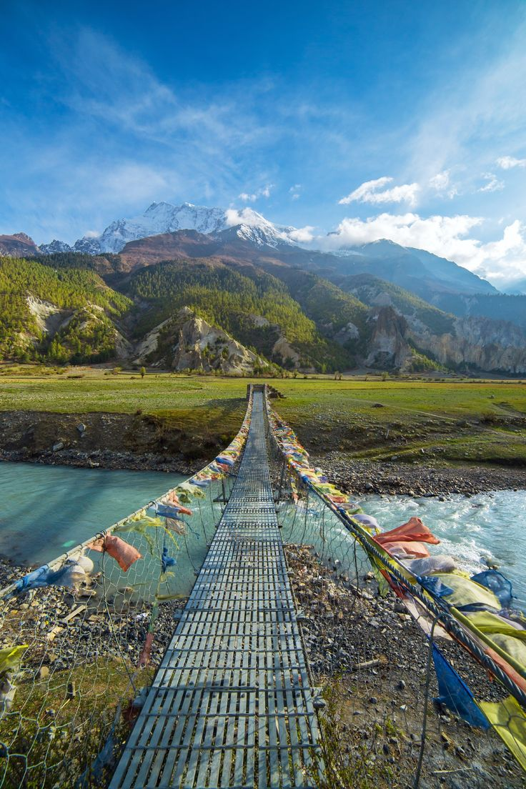 A suspension bridge leads the way to the Annapurna Circuit in Nepal.  ©Alexander Mazurkevich/Shutterstock.