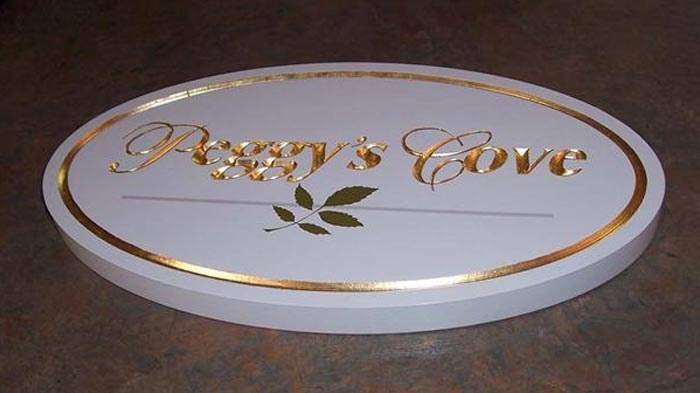 V-carved High Density Urethane.  Hand painted and gold leafed by Created by Jackie Shields, www.saugeensignworks.com