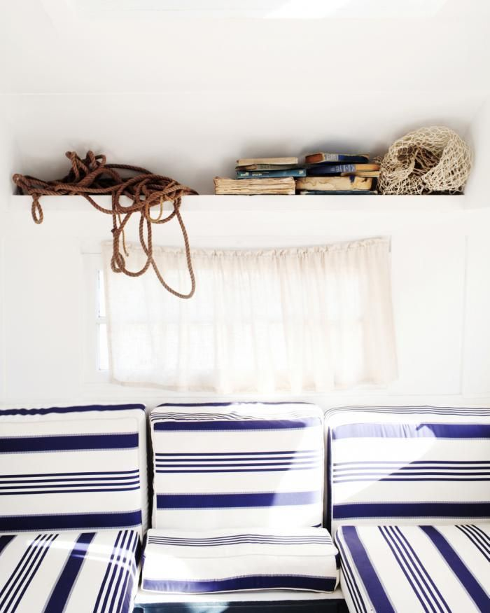 Inside. Completely restored vintage Franklin Caravan (1956). Travelling Wares by Kara Rosenlund: nautical stripes