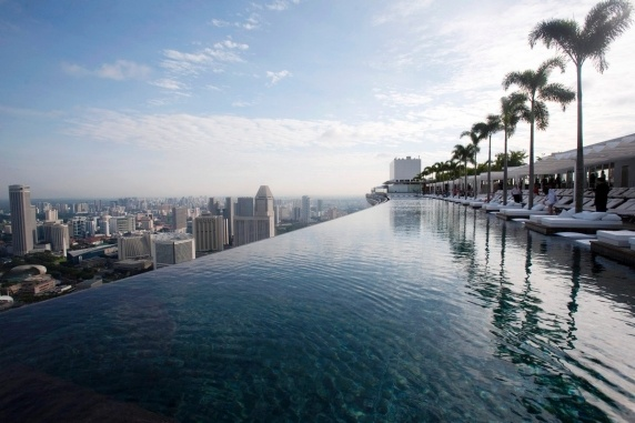 Skypark, Singapore... 650 in the air on the 55th floor of the hotel, making it the largest pool in the world at that height. The platform holding the pool, which spans all three towers of the hotel, is longer than the Eiffel Tower is tall.