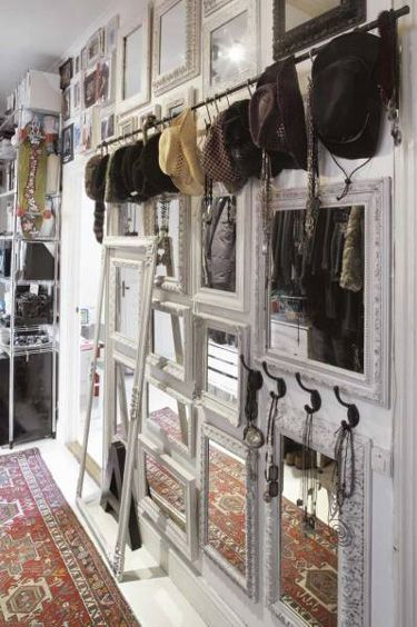 Old frames, mirrors and hooks. Such a charming wall.