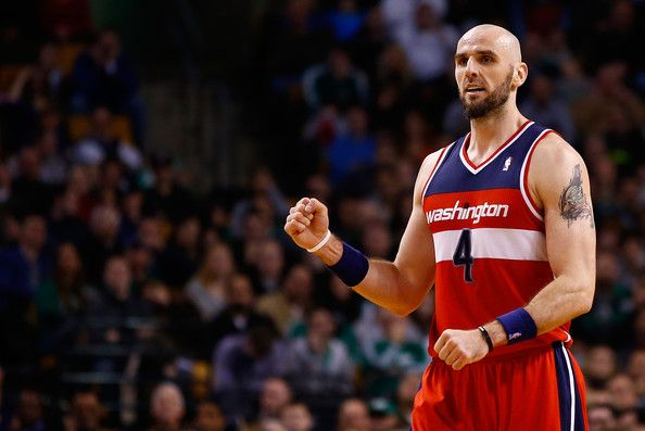 Marcin Gortat Casually Hangs Out in Celtics Huddle (Video)- http://getmybuzzup.com/wp-content/uploads/2014/04/273288-thumb.jpg- http://getmybuzzup.com/marcin-gortat-casually-hangs-celtics-huddle-video/- By Jeff Greenwell Someone might want to mention to the Boston Celtics that allowing an opponent into the huddle when you're down 17 points isn't the best strategy when you're trying to mount a comeback. Props to the Wizards Marcin Gortat for his ninja-like st