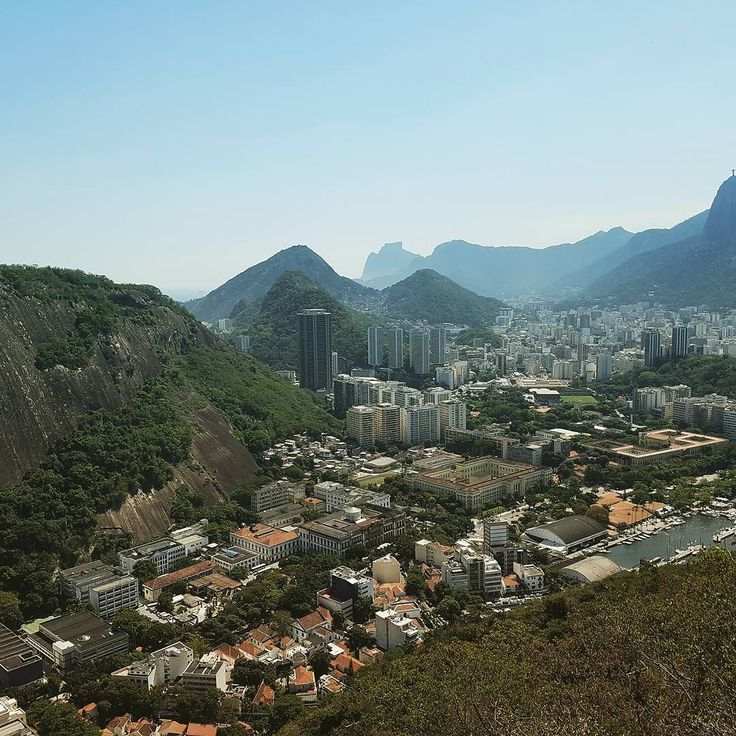 Sugarloaf Mountain is a peak situated in Rio de Janeiro Brazil at the mouth of Guanabara Bay on a peninsula that juts out into the Atlantic Ocean.