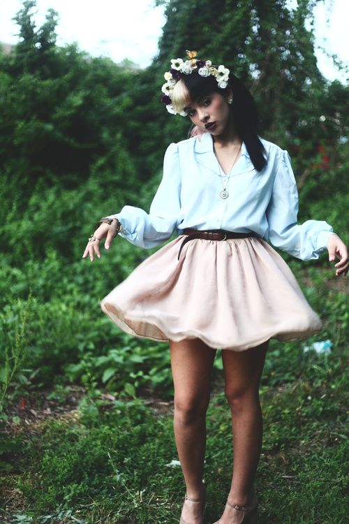 Melanie Martinez poses herself in a way that suggests she's in possession…<<woah but she's so prettyyy