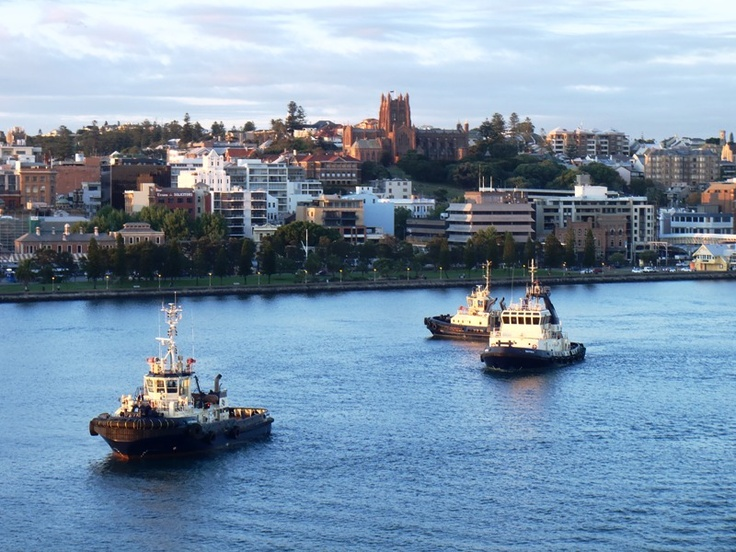 Newcastle, NSW.  The cathedral on the hill, the harbour foreshore and the Hunter River and waiting tugs.  The lifeblood of the Hunter Valley.