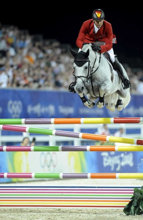 German show jumper Marco Kutscher and horse Cornet Obolensky compete in the 2nd qualifier of the jumping team event at the Equestrian Venue - Beijing Olympic Games 2008 in Hong Kong