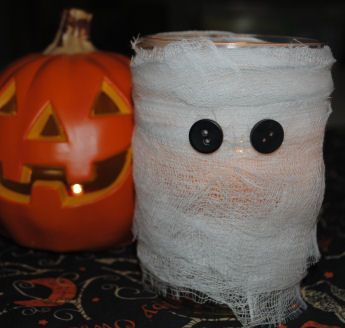 free halloween mummy craft project tutorial how to make a mason jar mummy candle craft for halloween using cheesecloth - Halloween Mummy Crafts