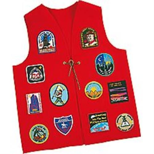Brag Vest Pattern - this can be sewn by Parents, or by Cub Scouts as a craft project, The only seams are in the shoulders and the optional front tie.  Draw a 1 inch grid on a piece of 18 x 24 in cardboard and draw the vest pattern onto it using the grid as a guide. #Scouts #Scouting
