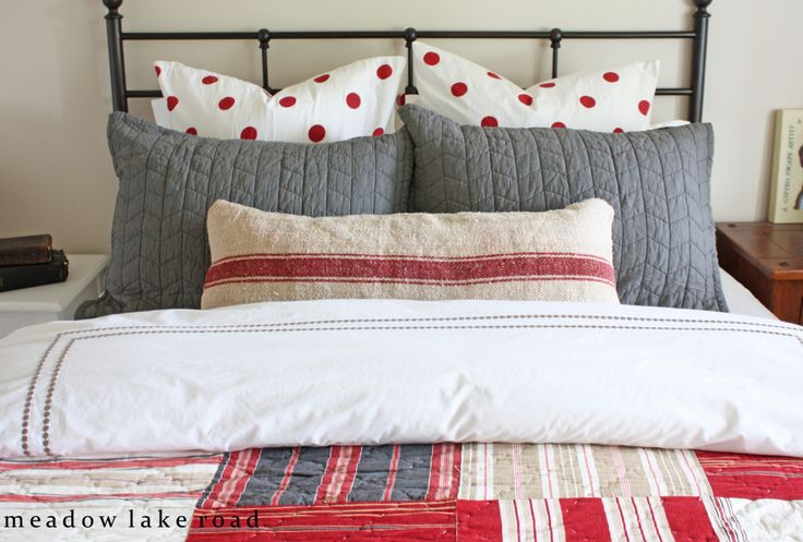 How I shopped around to find mix and match bedding pieces to create an eclectic, layered look on our guest bed.