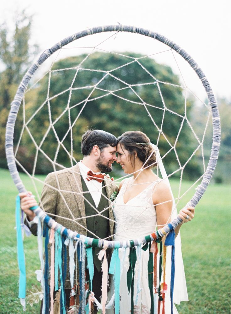 Colorful giant dream catcher: Photography : Graham Terhune Read More on SMP: http://www.stylemepretty.com/little-black-book-blog/2016/03/30/cozy-rustic-wedding-complete-with-giant-dream-catchers/
