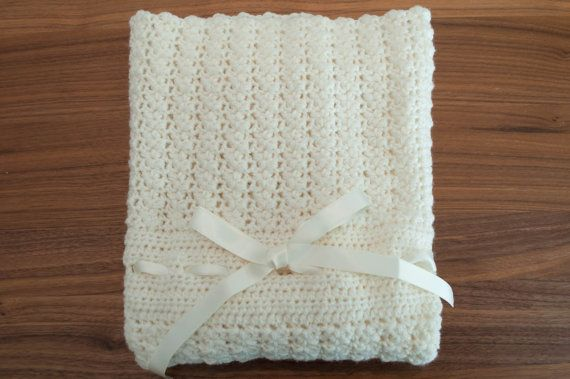 The Minimis Blanket - a crochet pattern. Crochet pattern for a baby blanket. Perfect for any stroller or newborn child. Easy to modify to make longer or wider if you want. Size: One. Baby blanket   stroller blanket   easy crochet pattern   joy of motion design   crochet pattern for a mother   newborn crochet pattern   gift crochet pattern. Click to purchase or repin to save it forever.